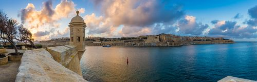 Senglea, Malta - Sunset and panoramic skyline view at the watch tower of Fort Saint Michael, Gardjola Gardens with beautiful sky Royalty Free Stock Photo