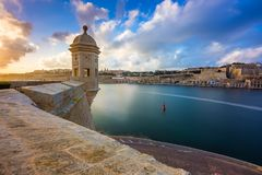 Senglea, Malta - Watch tower at Fort Saint Michael, Gardjola Gardens at sunset. With beautiful sky and clouds Royalty Free Stock Photos