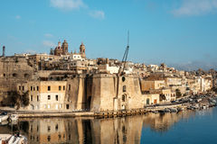Senglea peninsula in Grand Bay, Valetta, Malta. Valetta harbor in the morning, Senglea peninsula in morning light. This image is toned Royalty Free Stock Images