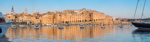 Senglea peninsula in Grand Bay, Valetta, Malta, on a sunrise. Senglea peninsula in Grand Bay of Valetta, Malta, on a sunrise Royalty Free Stock Photos