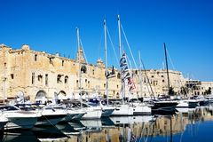 Senglea waterfront buildings and marina, Malta. View of Senglea and marina and waterfront buildings seen from Vittoriosa, Senglea, Malta, Europe Stock Images