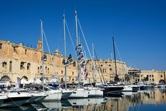 Senglea waterfront buildings and marina, Malta. View of Senglea and marina and waterfront buildings seen from Vittoriosa, Senglea, Malta, Europe Royalty Free Stock Images