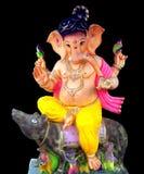Senhor Ganesha que senta-se no rato Foto de Stock Royalty Free