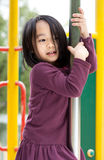 Senhora asiática pequena em um campo de jogos Fotografia de Stock Royalty Free