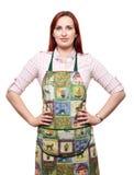 A senhora atrativa no avental, apronta-se para cozinhar! Fotos de Stock