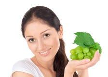 Senhora atrativa nova com o conjunto verde da uva Imagens de Stock
