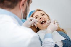 Senhora bonita otimista que obtém seus dentes verificados Fotografia de Stock Royalty Free