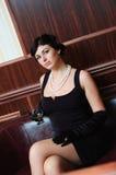 Senhora com o vidro do conhaque. Imagens de Stock