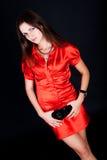 Senhora da estada no vestido vermelho Fotos de Stock Royalty Free