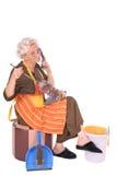 Senhora de limpeza no telefone fotografia de stock royalty free