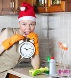 Senhora de limpeza nova com despertador Imagem de Stock Royalty Free