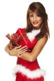 Senhora de Santa que mantem um presente isolado no branco Fotografia de Stock