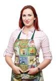 Senhora de sorriso atrativa no avental Imagem de Stock