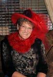 Senhora de sorriso de Red Hat Fotografia de Stock