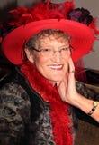 Senhora de sorriso mais idosa de Red Hat Imagem de Stock Royalty Free