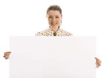 Senhora do negócio que prende um sinal em branco Imagem de Stock Royalty Free