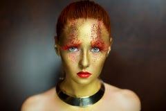 Senhora dourada Foto de Stock