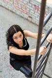 Senhora em escadas Fotos de Stock
