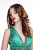Senhora lindo à moda com as joias que olham para baixo Imagens de Stock Royalty Free