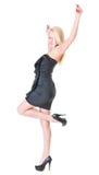 Senhora loura 'sexy' no vestido preto contra o branco fotos de stock royalty free