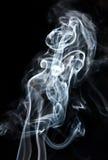 Senhora no fumo, ilusão. Imagem de Stock