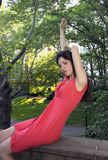 Senhora no vermelho no parque Imagens de Stock