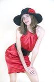 A senhora no vestido e no chapéu vermelhos Imagem de Stock Royalty Free
