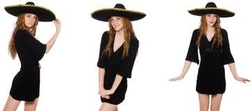 A senhora nova do ruivo no vestido preto com sombreiro preto fotografia de stock