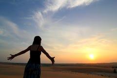 Senhora Revestimento Por do sol Imagem de Stock