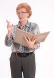 Senhora superior com livro Fotografia de Stock Royalty Free