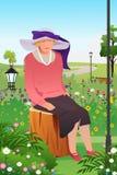Senhora superior em um jardim Imagens de Stock Royalty Free