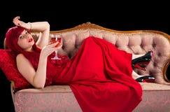 Senhora vermelha com vinho Foto de Stock Royalty Free