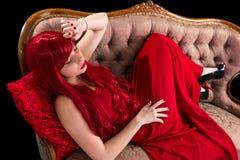 Senhora vestida vermelho dentro embora Imagem de Stock Royalty Free