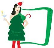 Senhorita Claus com um vestido da árvore de abeto. Foto de Stock