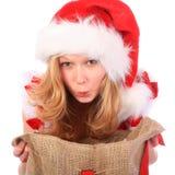 Senhorita espantada Santa com saco do Natal imagens de stock
