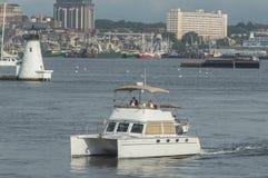 Senhorita My Money do cruzador com New Bedford no fundo Fotos de Stock Royalty Free