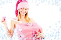 Senhorita Santa com presente Fotografia de Stock Royalty Free
