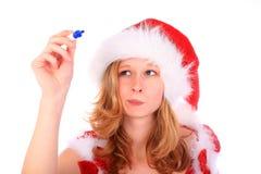 A senhorita Santa está escrevendo com uma pena de marcador azul fotografia de stock
