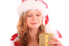 A senhorita Santa está feliz sobre uma caixa de presente Fotografia de Stock
