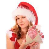 A senhorita Santa está prendendo um saco extravagante do presente imagens de stock