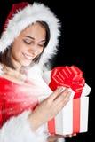 Senhorita Santa que abre uma caixa de presente Fotos de Stock