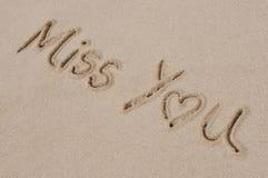 Senhorita Você Written na areia Fotografia de Stock Royalty Free