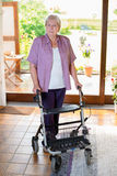 Senieor with walking frame Stock Images