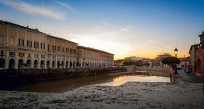 Senigallia, the Misa river crosses the historical center of the city at sunset. Marche, Italy. Beautiful sunset on the river that runs through the city at sunset royalty free stock images