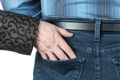 Senile hand in the pocket of man Stock Photos