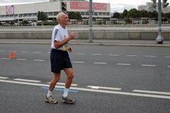 Senion man runs Moscow Marathon Stock Photos