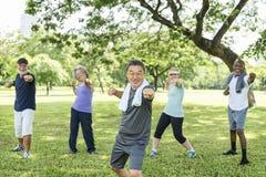 Seniorów przyjaciół Grupowy ćwiczenie Relaksuje pojęcie Obraz Royalty Free