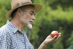 Senior. Posing with an apple in the garden Stock Image