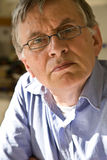 Senior. A senior male model with reading glasses royalty free stock photography