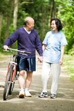 Senior active asian couple. A senior active asian couple walking and exercise at the park Stock Photography